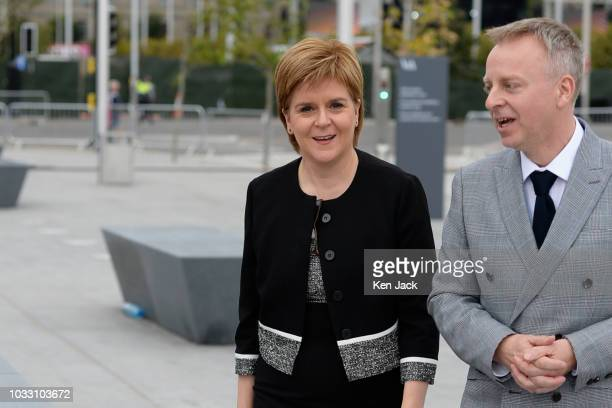 Scotland's First Minister Nicola Sturgeon is welcomed to the new VA Dundee by museum director Philip Long on September 14 2018 in Dundee Scotland