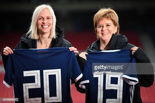 Scotland's First Minister Nicola Sturgeon joins Shelley Kerr head coach of Scotland and players at Hampden Park during the announcement of a funding...