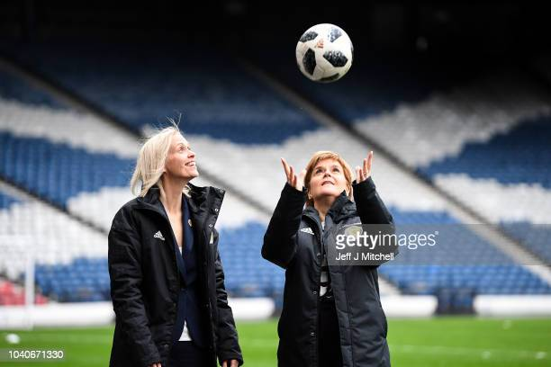 Scotland's First Minister, Nicola Sturgeon, joins Shelley Kerr head coach of Scotland at Hampden Park during the announcement of a funding agreement...
