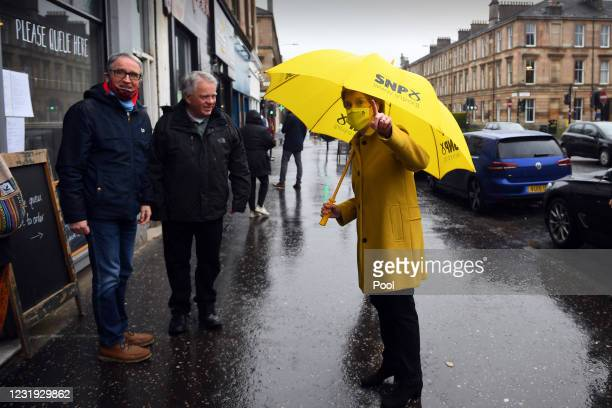 Scotland's First Minister Nicola Sturgeon, leader of the Scottish National Party , wearing a mask because of the coronavirus pandemic, talks to...