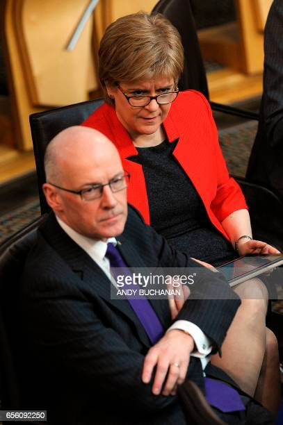Scotland's First Minister Nicola Sturgeon listens with Deputy First Minister John Swinney during the first day of the 'Scotland's Choice' debate on a...