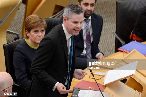 Scotland's First Minister Nicola Sturgeon looks on as Finance Secretary Derek Mackay opens the Stage 3 budget debate in the Scottish Parliament on...