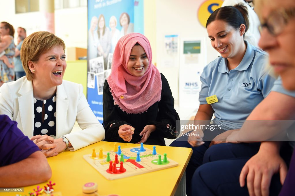 Scotland's First Minister Nicola Sturgeon (L) meets staff and patients during a visit to the Royal Hospital for Children to mark the 70th Anniversary of the NHS on July 5, 2018, in Glasgow, United Kingdom. Welsh Labour MP and Health Minister, Aneurin 'Nye' Bevan, formed the National Health Service on 5 July 1948. It is the publicly funded national healthcare system for the UK.