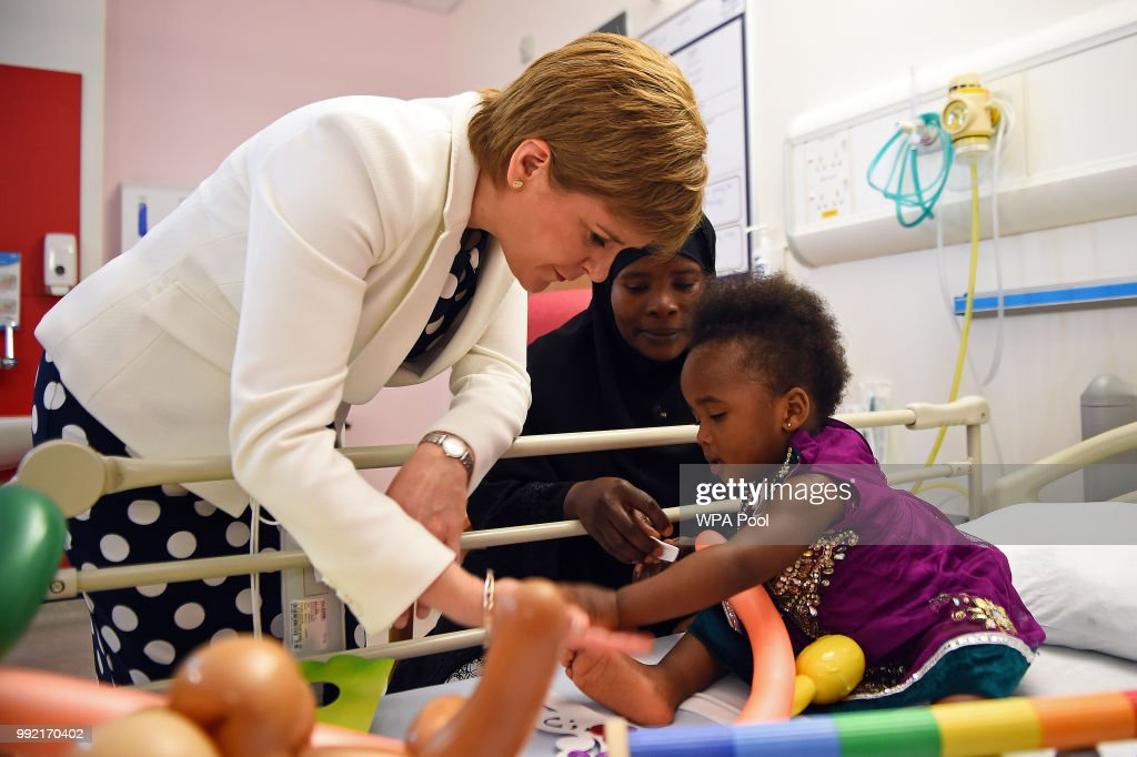 Scotland's First Minister Nicola Sturgeon (L) meets with 20-month-old Hibatullah Kizito during a visit to the Royal Hospital for Children to mark the 70th Anniversary of the NHS on July 5, 2018, in Glasgow, United Kingdom. Welsh Labour MP and Health Minister, Aneurin 'Nye' Bevan, formed the National Health Service on 5 July 1948. It is the publicly funded national healthcare system for the UK.