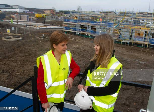 Scotland's First Minister Nicola Sturgeon meets with Zofia Piotrowska Training officer with Moretti Care during a visit to a building site in...