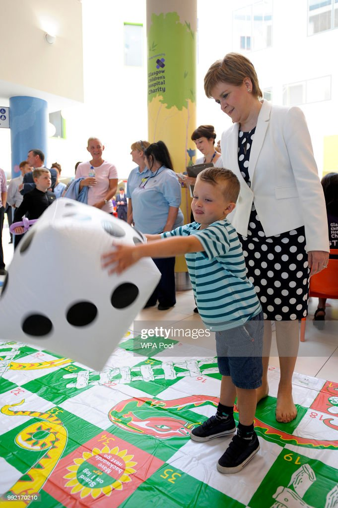 Scotland's First Minister Nicola Sturgeon (R) plays with 4-year-old Noah Cannine during a visit to the Royal Hospital for Children to mark the 70th Anniversary of the NHS on July 5, 2018, in Glasgow, United Kingdom. Welsh Labour MP and Health Minister, Aneurin 'Nye' Bevan, formed the National Health Service on 5 July 1948. It is the publicly funded national healthcare system for the UK.
