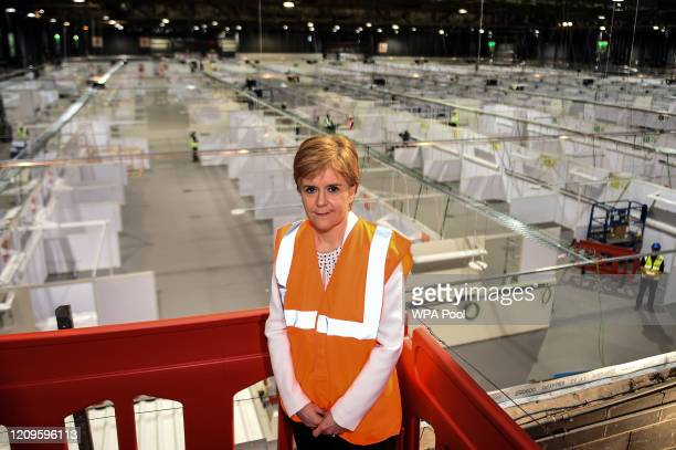 Scotland's First Minister Nicola Sturgeon poses for a photograph above the main hall during a visit to the NHS Louisa Jordan field hospital, set up...