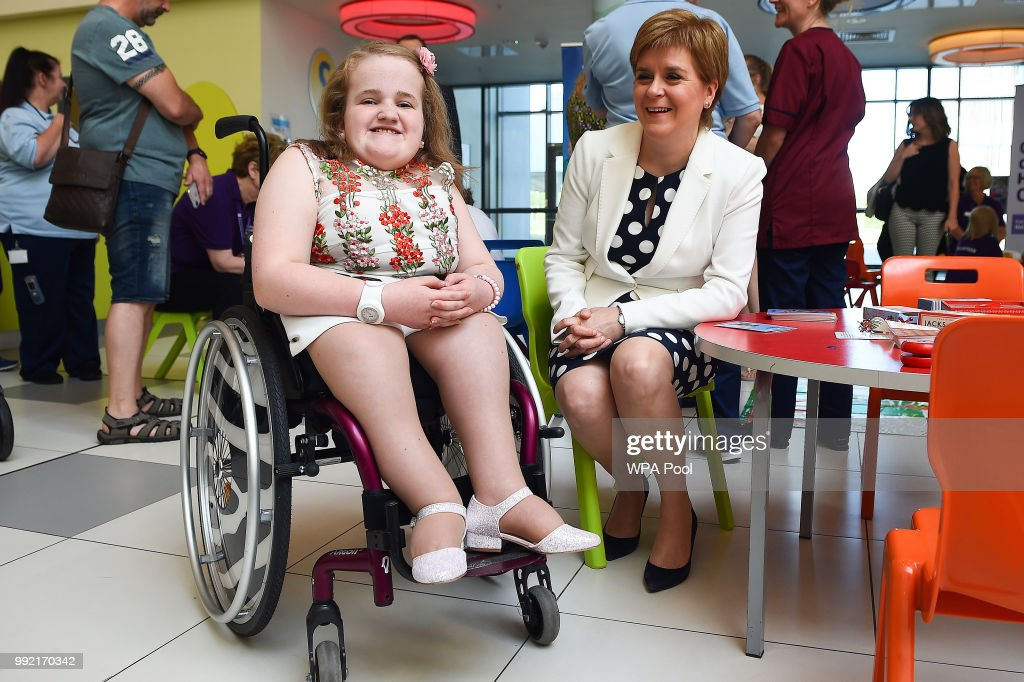 Scotland's First Minister Nicola Sturgeon (R) poses for a photograph with 14-year-old Ella Chambers during a visit to the Royal Hospital for Children to mark the 70th Anniversary of the NHS on July 5, 2018, in Glasgow, United Kingdom. Welsh Labour MP and Health Minister, Aneurin 'Nye' Bevan, formed the National Health Service on 5 July 1948. It is the publicly funded national healthcare system for the UK.