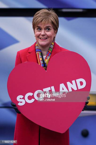 Scotland's First Minister Nicola Sturgeon poses for photographs with a love heart outside the Holyrood on December 11 2019 in Edinburgh Scotland The...