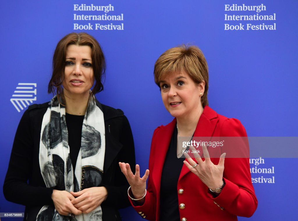 Scotland's First Minister Nicola Sturgeon (R) poses for photographs with author Elif Shafak (L) during the Edinburgh International Book Festival on August 18, 2017 in Edinburgh, Scotland. Both were taking part in a Book Festival talk on 'Life Under Public Scrutiny'.