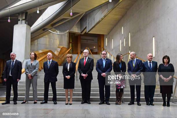 Scotland's First Minister Nicola Sturgeon prepares to observe a minute's silence in the Garden Lobby of the Scottish Parliament for the victims of...
