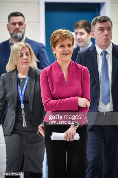 Scotland's First Minister Nicola Sturgeon reacts as she visits Spirit Aero Systems in Prestwick, Scotland on February 28 where she opened a new...
