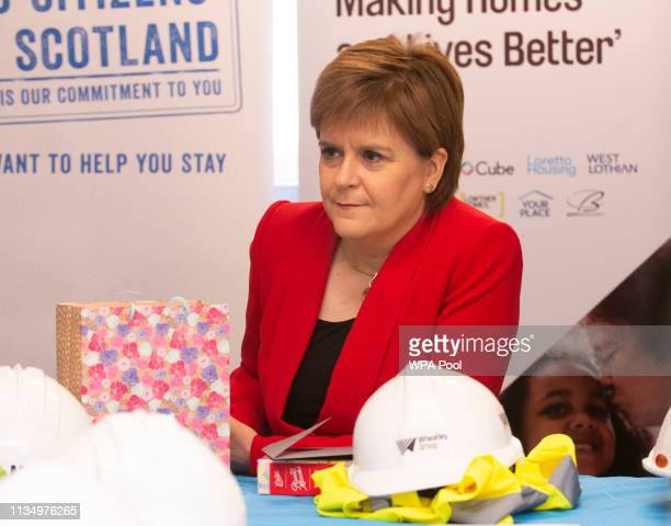 Scotland's First Minister Nicola Sturgeon receives and hands round chocolates during a visit to a building site in Easterhouse on April 5 2019 in...