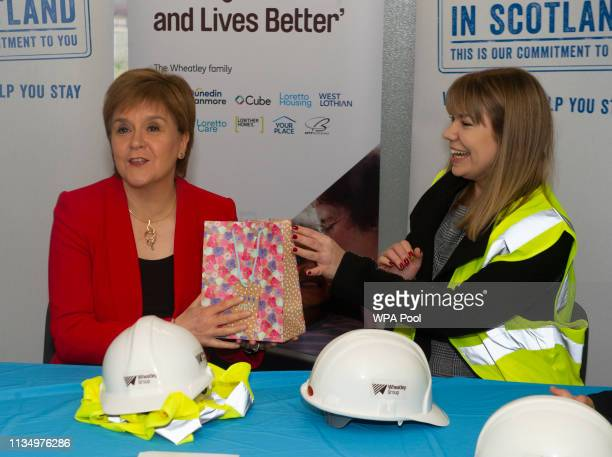 Scotland's First Minister Nicola Sturgeon receives chocolates during a visit to a building site in Easterhouse on April 5 2019 in Glasgow Scotland...