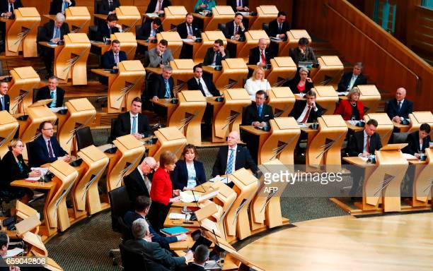 Scotland's First Minister Nicola Sturgeon stands and speaks in the chamber on the second day of the 'Scotland's Choice' debate on a motion to seek...