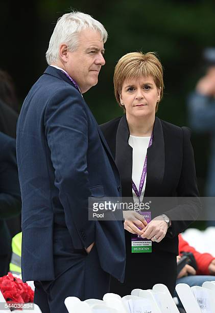 Scotland's First Minister Nicola Sturgeon stands with First Minister of Wales Carwyn Jones as they wait to take their seats at the Commemoration of...