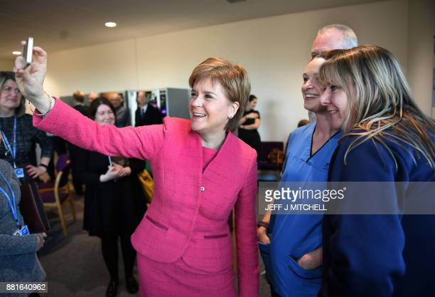 Scotland's First Minister Nicola Sturgeon takes a selfie with staff members during her visit to formally open the Royal Edinburgh Building on the...