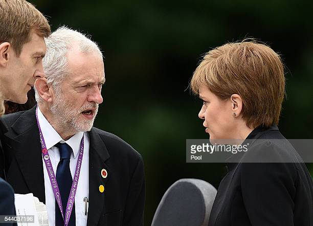 Scotland's First Minister Nicola Sturgeon talks with Labour Party leader Jeremy Corbyn as they wait to take their seats at the Commemoration of the...