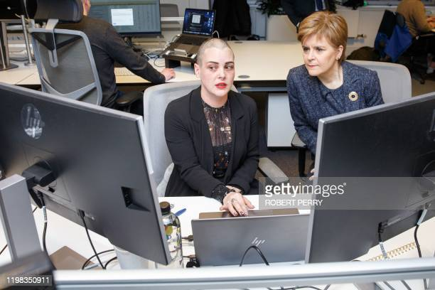 Scotland's First Minister Nicola Sturgeon talks with software engineer Louise Meney during her visit to software developer Encompass Corporation's...