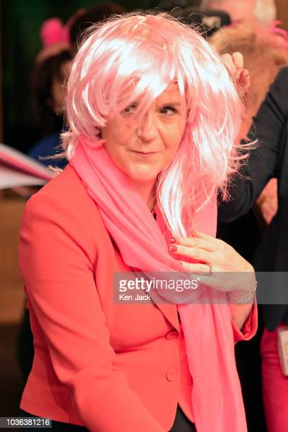 Scotland's First Minister Nicola Sturgeon tries on a pink wig before posing after First Minister's Questions in the Scottish Parliament to promote a...