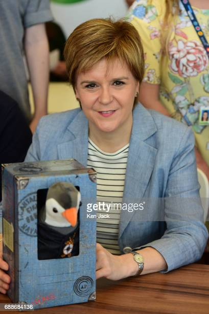 Scotland's First Minister Nicola Sturgeon was presented with British Gas mascot Wilbur the Penguin as she met young apprentices staff and management...