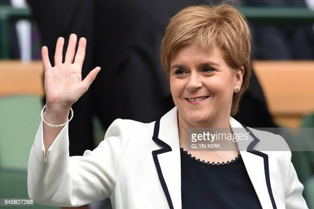 Scotland's First Minister Nicola Sturgeon waves from the royal box on centre court before the men's singles final match on the last day of the 2016...