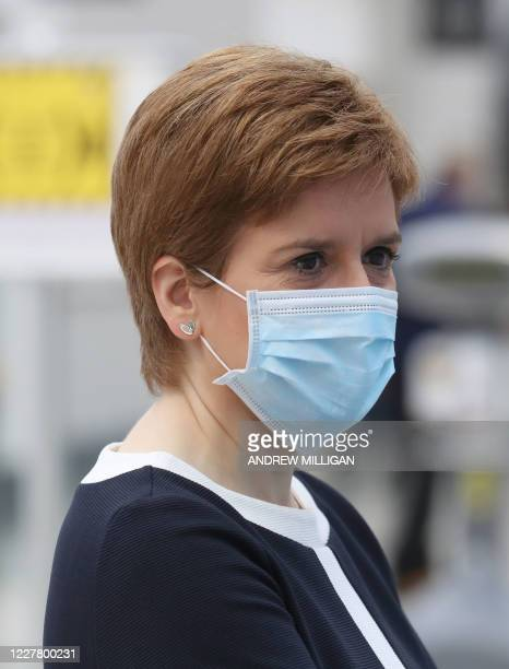 Scotland's First Minister Nicola Sturgeon wears a face mask during her visit to the field hospital the NHS Louisa Jordan, set up at the SEC in...