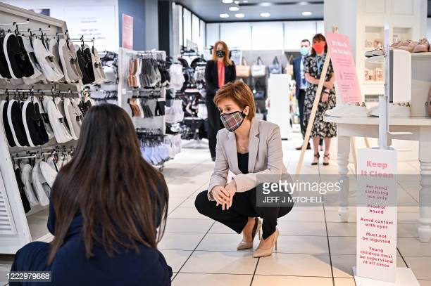 Scotland's First Minister, Nicola Sturgeon wears a Tartan face mask as she visits New Look at Ford Kinaird Retail Park in Edinburgh on June 26 as...