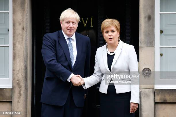 Scotland's First Minister Nicola Sturgeon welcomes Prime Minister Boris Johnson outside Bute House on July 29 2019 in Edinburgh Scotland The PM is...