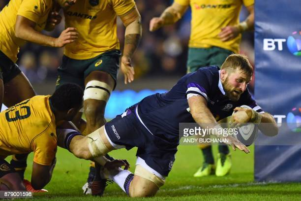 Scotland's flanker John Barclay dives over the line to score a try during the autumn international rugby union test match between Scotland and...