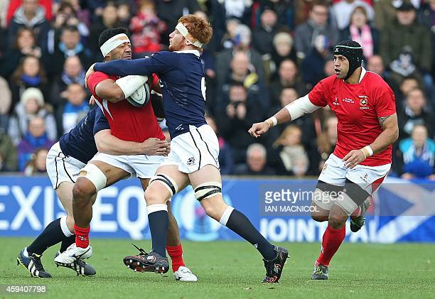 Scotland's flanker Rob Harley tackles Tonga's number 8 Viliami Ma'afu during the Autumn International rugby union Test match between Scotland and...
