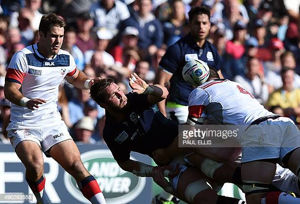 Scotland's flanker Ryan Wilson is tackled by US lock Hayden Smith next to US centre Seamus Kelly during a Pool B match of the 2015 Rugby World Cup...