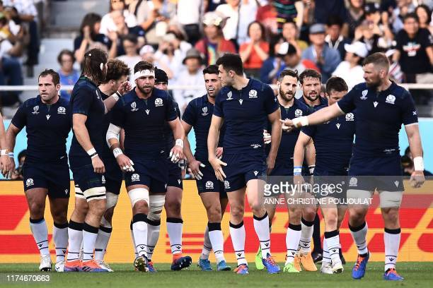 Scotland's flyhalf Adam Hastings celebrates with after scoring a try during the Japan 2019 Rugby World Cup Pool A match between Scotland and Russia...