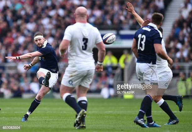 Scotland's fly-half Finn Russell attempts a drop goal during the Six Nations international rugby union match between England and Scotland at...