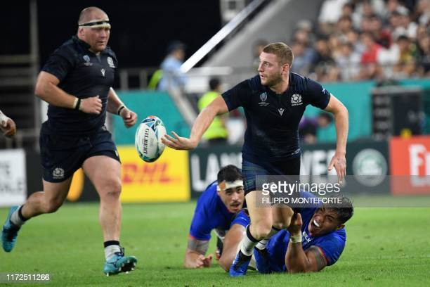 Scotland's fly-half Finn Russell passes the ball during the Japan 2019 Rugby World Cup Pool A match between Scotland and Samoa at the Kobe Misaki...