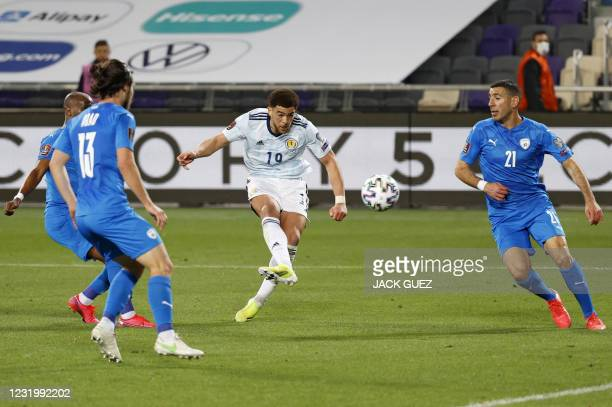 Scotland's forward Che Adams attempts a shot as he is watched by Israel's defender Eitan Tibi during the 2022 FIFA World Cup qualifier group F...