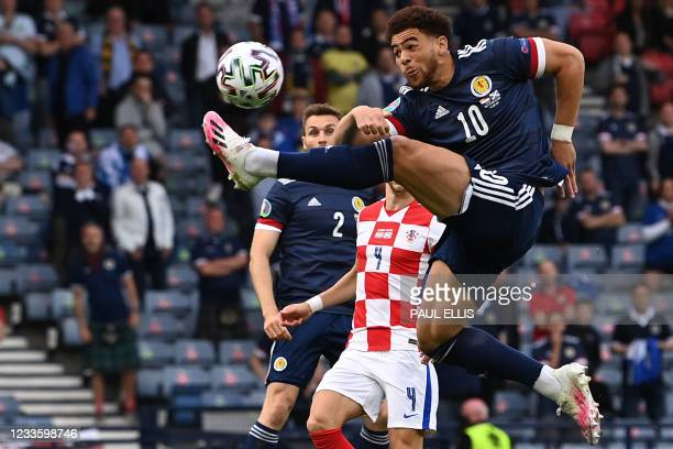 Scotland's forward Che Adams stretches to reach the ball during the UEFA EURO 2020 Group D football match between Croatia and Scotland at Hampden...