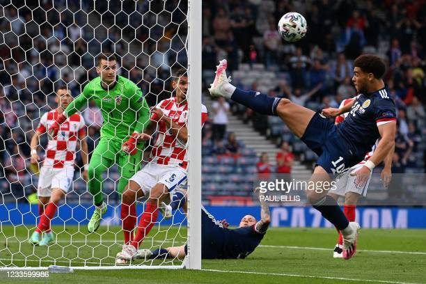 Scotland's forward Che Adams vies for the ball during the UEFA EURO 2020 Group D football match between Croatia and Scotland at Hampden Park in...