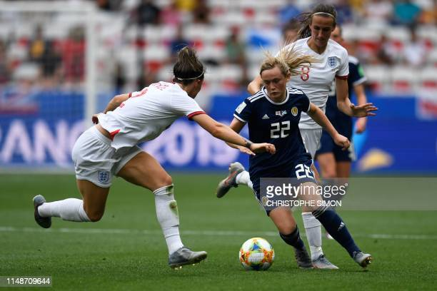 Scotland's forward Erin Cuthbert vies for the ball with England's defender Lucy Bronze and England's midfielder Jill Scott during the France 2019...