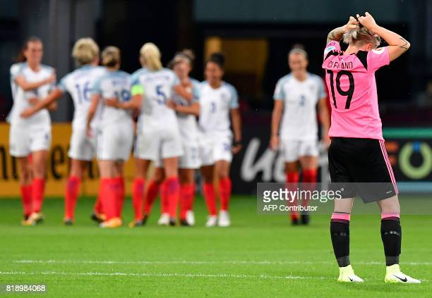 Scotland's forward Lana Clelland fixes her hair as England's player celebrate scoring during the UEFA Women's Euro 2017 football tournament match...