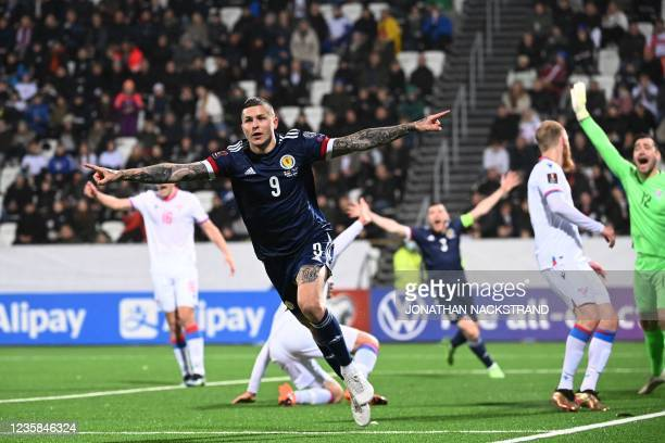 Scotland's forward Lyndon Dykes celebrates scoring the 1-0 goal during the football match between Faroe Islands and Scotland, in the Torsvollur...