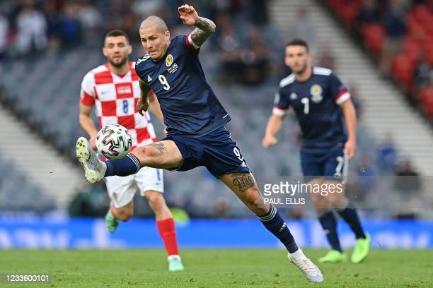 Scotland's forward Lyndon Dykes controls the ball during the UEFA EURO 2020 Group D football match between Croatia and Scotland at Hampden Park in...