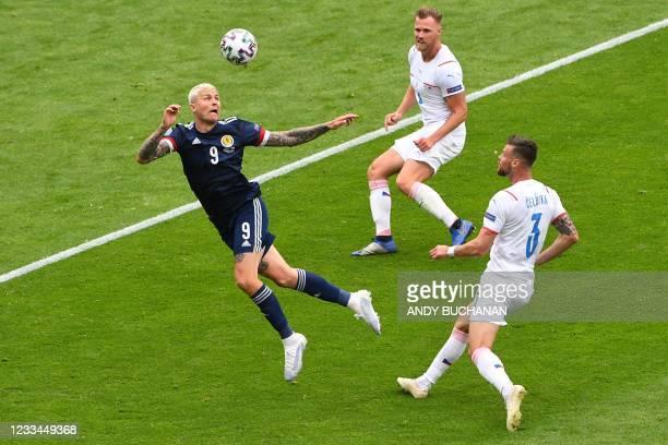 Scotland's forward Lyndon Dykes heads the ball during the UEFA EURO 2020 Group D football match between Scotland and Czech Republic at Hampden Park...