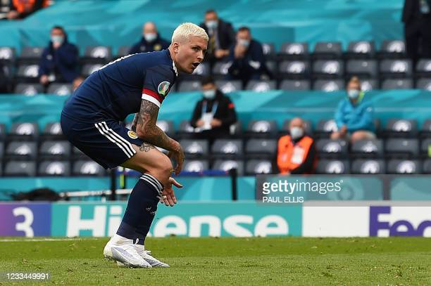 Scotland's forward Lyndon Dykes reacts after missing a shot at goal during the UEFA EURO 2020 Group D football match between Scotland and Czech...