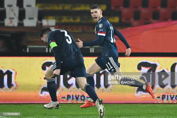 Scotland's forward Ryan Christie celebrates with Scotland's defender Andrew Robertson after scoring a goal during the Euro 2020 play-off...