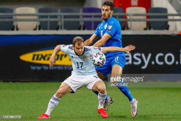 Scotland's forward Ryan Fraser is marked by Israel's defender Hatem Elhamed during the 2022 FIFA World Cup qualifier group F football match between...