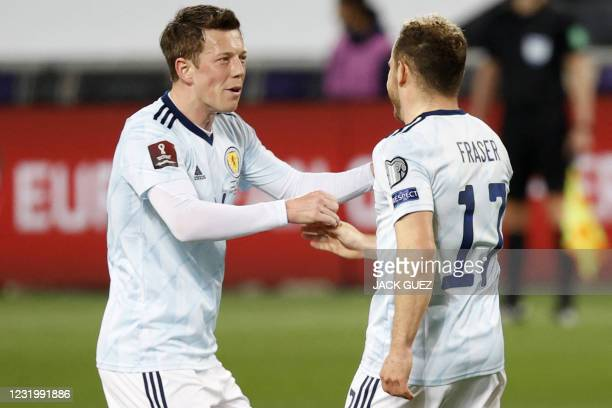 Scotland's forwrad Ryan Fraser is congratulated for his goal by teammate Callum McGregor during the 2022 FIFA World Cup qualifier group F football...