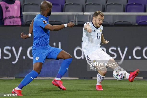 Scotland's forwrad Ryan Fraser is marked by Israel's defender Eli Dasa during the 2022 FIFA World Cup qualifier group F football match between Israel...