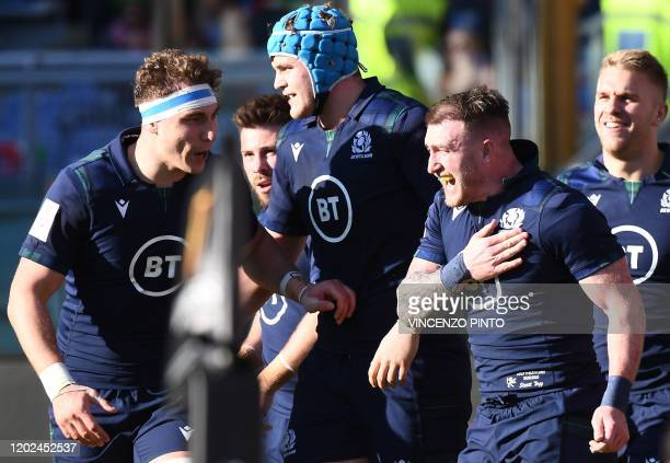 Scotland's full back Stuart Hogg celebrates after scoring a try during the Six Nations international rugby union match between Italy and Scotland at...