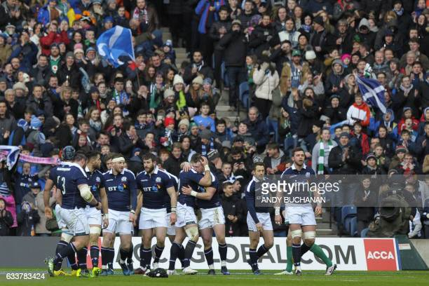 Scotland's full back Stuart Hogg celebrates after scoring a try during the Six Nations international rugby union match between Scotland and Ireland...